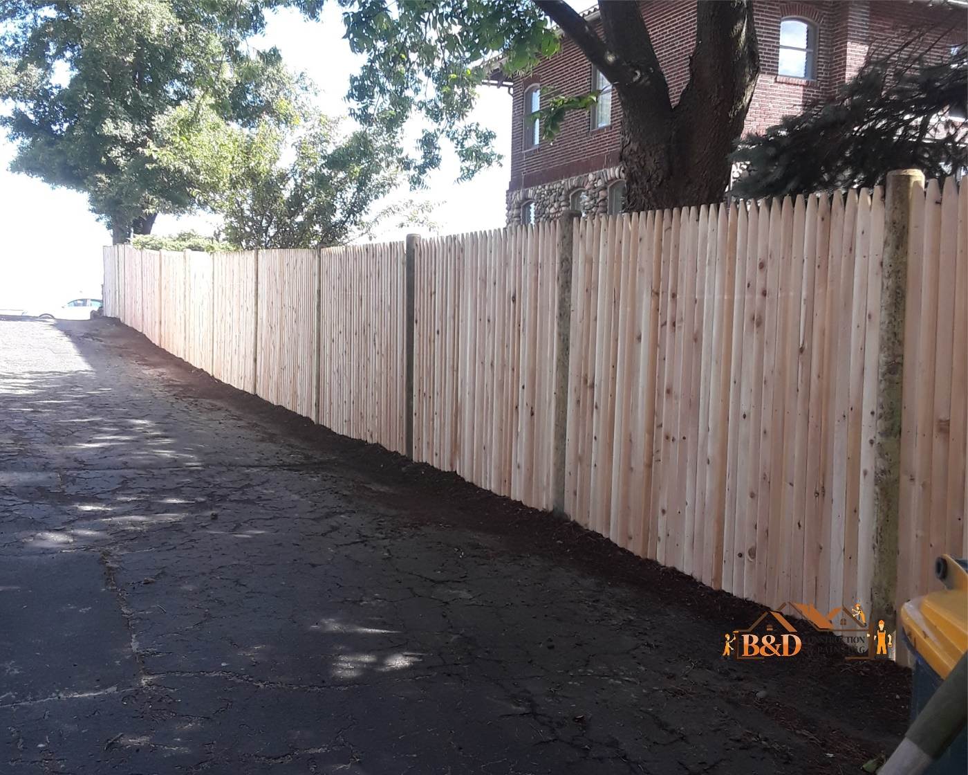 Wood Fence installation after